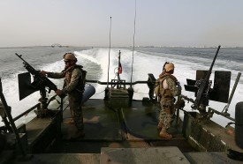 US Navy crew man machine-guns as they stand aboard a Riverine Command Boat off the coast of Bahrain's Salman port, near Manama, on May 12, 2013, one day before the start of the biggest exercise of mine countermeasure maneuvers in the Arabian Gulf. The US Navy along with other 40 nations are conducting the games. AFP PHOTO/MARWAN NAAMANI        (Photo credit should read MARWAN NAAMANI/AFP/Getty Images)