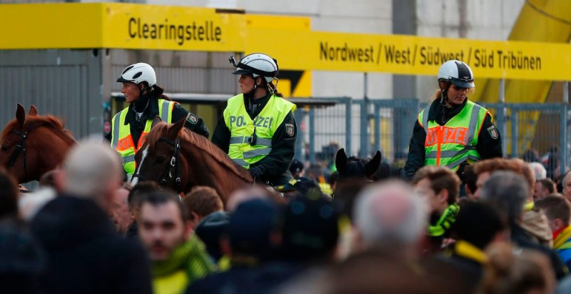TOPSHOT - Police patrol on horseback outide the stadium after the team bus of Borussia Dortmund had some windows broken by an explosion some 10km away from the stadium prior tothe UEFA Champions League 1st leg quarter-final football match BVB Borussia Dortmund v Monaco in Dortmund, western Germany on April 11, 2017. / AFP PHOTO / Odd ANDERSEN        (Photo credit should read ODD ANDERSEN/AFP/Getty Images)
