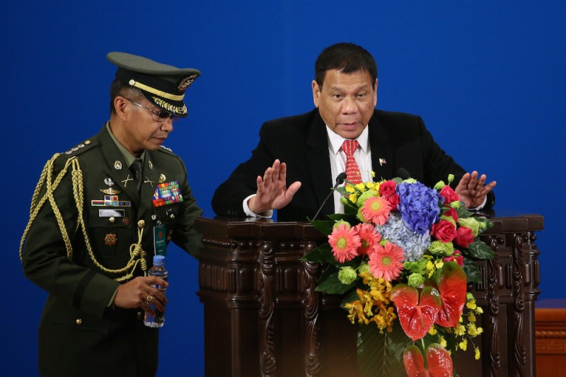 Philippines' President Rodrigo Duterte (R) makes a speech during the Philippines-China Trade and Investment Forum at the Great Hall of the People in Beijing on October 20, 2016.  Philippines' President Rodrigo Duterte and his Chinese counterpart Xi Jinping pledged to enhance trust and deepen cooperation October 20, Chinese officials said, as Manila's new leader seeks to rebalance his country's diplomacy away from the US. / AFP / POOL / WU HONG        (Photo credit should read WU HONG/AFP/Getty Images)