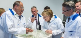 FRANKFURT AM MAIN, GERMANY - MAY 28:  German Chancellor Angela Merkel (3rdR) inspects an insulin pen as she visits the new production facility for sterile glass vials at the Sanofi pharmaceuticals plant on May 28, 2015 in Frankfurt, Germany. Sanofi Germany generalmanager Martin Siewert, CEO of Sanofi Olivier Brandicourt and the mayor of Frankfurt Peter Feldmann (L-R) stand by side. Merkel is visiting the factory, which produces antibiotics and insulin, ahead of the upcoming G7 summit, where the global struggle against antibiotic-resistant bacteria is among topics to be discussed by G7 leaders.  (Photo by Thomas Lohnes/Getty Images)