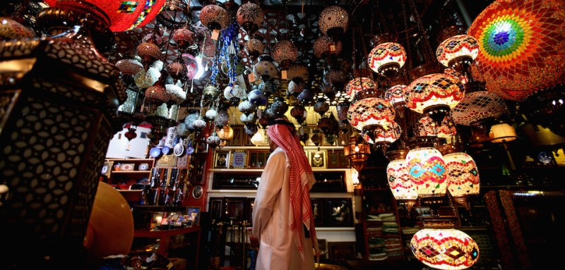 SHARJAH, UNITED ARAB EMIRATES - JULY 22: A man looks at antiques on display at Cenral Souq on July 22, 2015 in Sharjah, United Arab Emirates.  (Photo by Francois Nel/Getty Images)