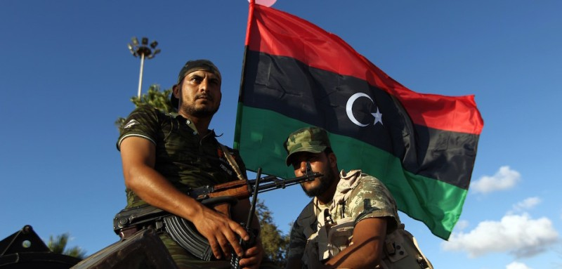 "Libyan troops loyal to Khalifa Haftar, a retired general and former chief of staff for Moamer Kadhafi, sit on an amoured personnel carrier (APC) during a demonstration calling on the international community to arm the Libyan army on August 14, 2015 in the eastern Libyan city of Benghazi. The Tobruk-based government (recognised by the international community) said in a statement that world powers were using ""double standards"" by fighting IS in Syria and Iraq and ""turning a blind eye"" to the presence of the jihadists in Libya.   AFP PHOTO / ABDULLAH DOMA        (Photo credit should read ABDULLAH DOMA/AFP/Getty Images)"