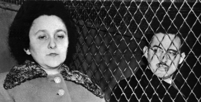 NEW YORK, UNITED STATES:  Julius (R, 1918-53) and Ethel Rosenberg (L, 1915-53) are seated in a police van in 1953 in New York shortly before their execution for espionage. Rosenberg, husband and wife, joined the US Communist Party, and were convicted of being part of a transatlantic spy ring uncovered after the trial of Klaus Fuchs in Britain. They were found guilty in a highly controversial trial of passing on atomic secrets to the Soviet Union and became the first US civilians to be executed for espionage in Sing Sing Prison 19 June 1953. (Photo credit should read AFP/AFP/Getty Images)