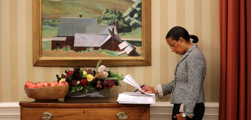 WASHINGTON, DC - OCTOBER 07:  U.S. National Security Advisor Susan Rice looks over documents as President Barack Obama talks with reporters following a meeting with his national security and disaster response teams to discuss Hurricane Matthew in the Oval Office at the White House October 7, 2016 in Washington, DC. The hurricane is now a category 3 and is headed for Florida after wreaking havoc in Haiti, Cuba and the Bahamas.  (Photo by Chip Somodevilla/Getty Images)