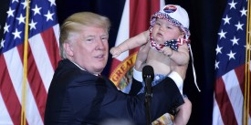 US Republican presidential nominee Donald Trump holds a baby during a rally in the Special Events Center of the Florida State Fairgrounds in Tampa, Florida on November 5, 2016. / AFP / Mandel NGAN        (Photo credit should read MANDEL NGAN/AFP/Getty Images)