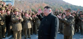 """This undated picture released by North Korea's Korean Central News Agency (KCNA) via KNS on March 7, 2017 shows North Korean leader Kim Jong-Un waving to North Korean officers during the launch of four ballistic missiles by Korean People's Army (KPA) during a military drill at an undisclosed location in North Korea. Nuclear-armed North Korea launched four ballistic missiles on March 6 in another challenge to President Donald Trump, with three landing provocatively close to America's ally Japan. / AFP PHOTO / KCNA VIA KNS / STR / South Korea OUT / REPUBLIC OF KOREA OUT   ---EDITORS NOTE--- RESTRICTED TO EDITORIAL USE - MANDATORY CREDIT """"AFP PHOTO/KCNA VIA KNS"""" - NO MARKETING NO ADVERTISING CAMPAIGNS - DISTRIBUTED AS A SERVICE TO CLIENTS THIS PICTURE WAS MADE AVAILABLE BY A THIRD PARTY. AFP CAN NOT INDEPENDENTLY VERIFY THE AUTHENTICITY, LOCATION, DATE AND CONTENT OF THIS IMAGE. THIS PHOTO IS DISTRIBUTED EXACTLY AS RECEIVED BY AFP.  /         (Photo credit should read STR/AFP/Getty Images)"""