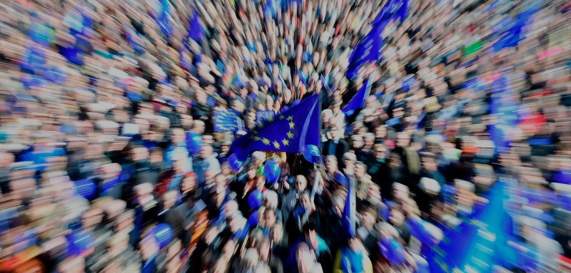 TOPSHOT - This picture taken with a zoom effect shows people attending a pro-Europe demonstration on March 26, 2017 in Berlin. / AFP PHOTO / Tobias SCHWARZ        (Photo credit should read TOBIAS SCHWARZ/AFP/Getty Images)