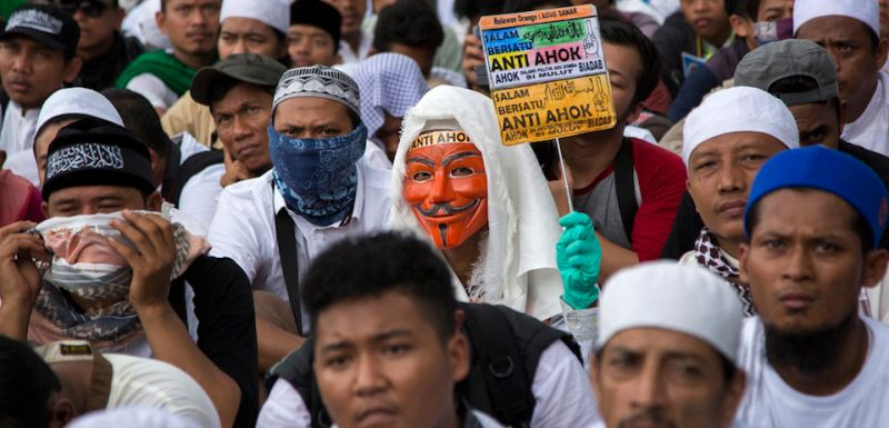 """JAKARTA, INDONESIA - MARCH 31: Thousands of Indonesian Muslims protest against the Jakarta governor Basuki Tjahaja Purnama known widely as """"Ahok"""" on March 31, 2017 in Jakarta, Indonesia.   The leader of one of the groups behind this protest and recent others was arrested Friday morning on suspicion of treason, as religious and political sentiments are increasingly contentious ahead of the Jakarta Governor election in April.(Photo by Ed Wray/Getty Images)"""