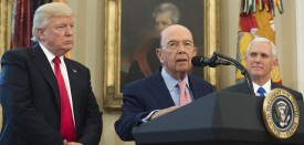 US President Donald Trump and US Vice President Mike Pence (R) stand alongside Commerce Secretary Wilbur Ross as he speaks about Trump signing executive orders on trade policies in the Oval Office of the White House in Washington, DC, March 31, 2017. / AFP PHOTO / SAUL LOEB        (Photo credit should read SAUL LOEB/AFP/Getty Images)
