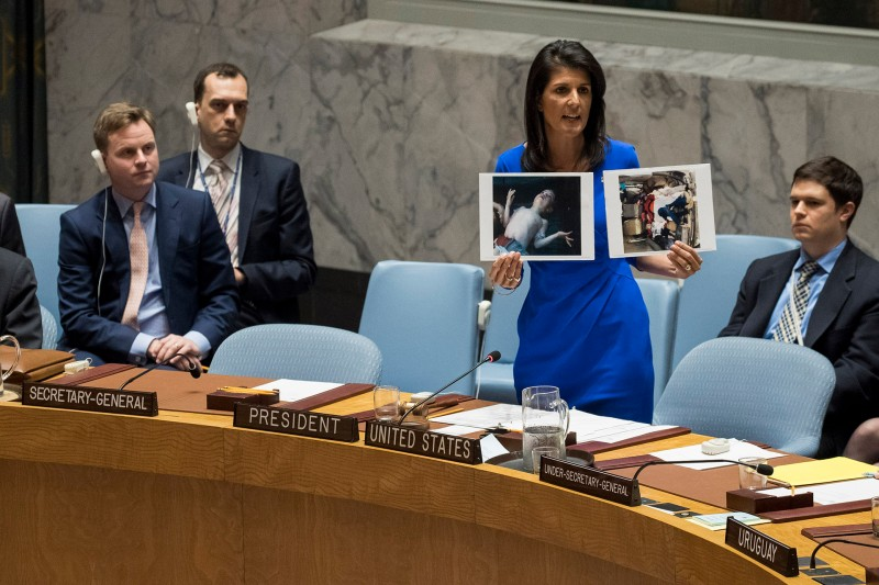 U.S. Ambassador to the United Nations Nikki Haley holds up photos of Syrian victims of a chemical attack during an April 5 meeting of the Security Council at U.N. headquarters in New York. (Photo credit: DREW ANGERER/Getty Images)