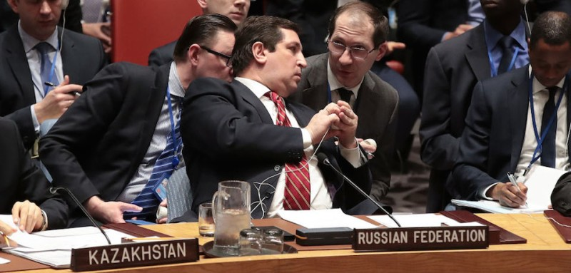 NEW YORK, NY - APRIL 7: Russian Deputy Permanent Representative to the United Nations Vladimir Safronkov confers with aides during a meeting of the United Nations Security Council concerning the situation in Syria, at UN headquarters, April 7, 2017 in New York City. On Thursday night, the United States launched airstrikes directed at Syrian government air bases in response to the chemical attack earlier in the week. (Photo by Drew Angerer/Getty Images)