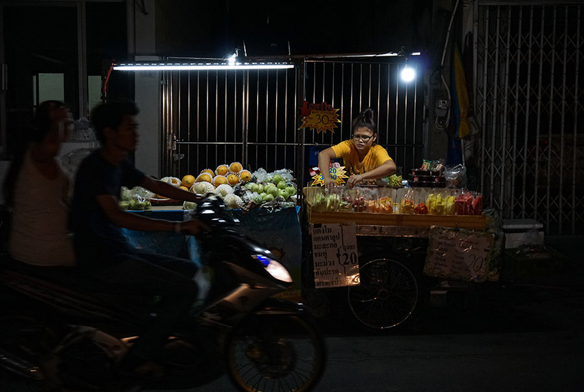 This photo taken on April 17, 2017 shows a woman selling fruit at a street stall in the Phrakanong district of Bangkok. Street food stalls will be banned from all of Bangkok's main roads under a clean-up crusade, a city hall official said Tuesday, prompting outcry and anguish in a food-obsessed capital famed for its spicey roadside cuisine.  / AFP PHOTO / LILLIAN SUWANRUMPHA        (Photo credit should read LILLIAN SUWANRUMPHA/AFP/Getty Images)