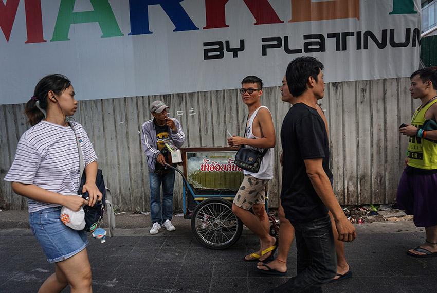 A man sells drinks from a street cart in the Pratunam district of Bangkok on April 18, 2017.  Street food stalls will be banned from all of Bangkok's main roads under a clean-up crusade, a city hall official said, prompting outcry and anguish in a food-obsessed capital famed for its spicey roadside cuisine. / AFP PHOTO / LILLIAN SUWANRUMPHA        (Photo credit should read LILLIAN SUWANRUMPHA/AFP/Getty Images)