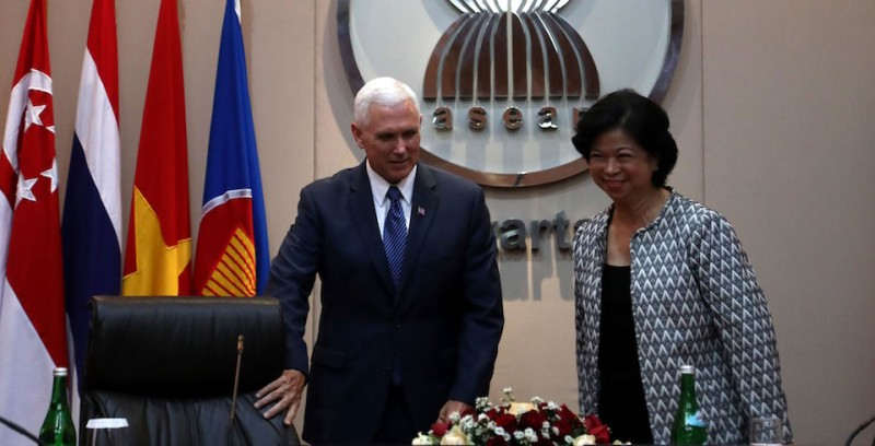 US Vice President Mike Pence (L) is accompanied by Elizabeth Buensuceso, the Philippine permanent representative for the Association of Southeast Asian Nations (ASEAN), during a meting at the ASEAN Secretariat in Jakarta on April 20, 2017. Pence is currently on a tour of South Korea, Japan, Indonesia and Australia that is aimed at smoothing some of the rougher edges of Trump's rhetoric. / AFP PHOTO / POOL / MAST IRHAM        (Photo credit should read MAST IRHAM/AFP/Getty Images)