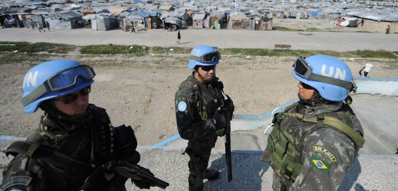 Brazilian soldiers (Brazil leads a mission of UN peacekeepers here) patrol a camp for survivors of the January 2010 quake in Haiti which killed 250,000 people, on February 28, 2013 in Port-au-Prince. The UN has had a huge mission in Haiti helping the impoverished country with its political strife and the impact the devastating 2010 quake. Hundreds of thousands are still living rough in squalid makeshift camps, and they now face rampant crime, a cholera outbreak and the occasional hurricane. AFP PHOTO/VANDERLEI ALMEIDA        (Photo credit should read VANDERLEI ALMEIDA/AFP/Getty Images)