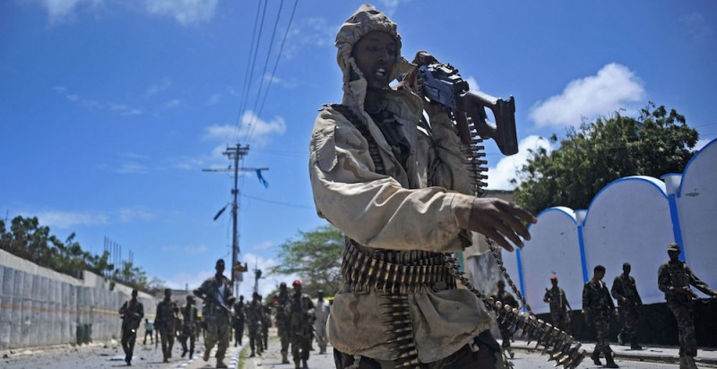 TOPSHOT - Somali security forces patrol the scene of a suicide car bomb blast on August 30, 2016 in Mogadishu.   At least seven people were killed on August 30 when jihadists exploded a suicide car bomb outside a popular hotel close to the presidential palace in Somalia's capital Mogadishu. The Al-Qaeda aligned Shabaab jihadists claimed responsibility for the attack on the SYL hotel which was previously attacked in both February 2016 and January 2015.  / AFP / Mohamed ABDIWAHAB        (Photo credit should read MOHAMED ABDIWAHAB/AFP/Getty Images)