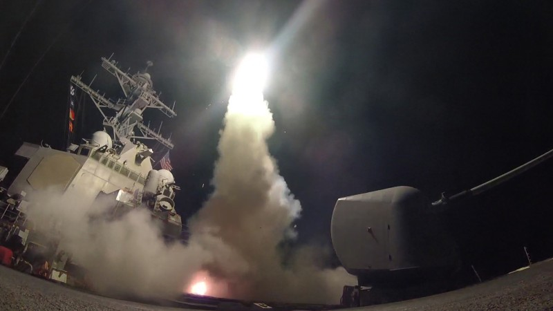MEDITERRANEAN SEA - APRIL 7:  In this handout provided by the U.S. Navy,The guided-missile destroyer USS Porter fires a Tomahawk land attack missile on April 7, 2017 in the Mediterranean Sea. The USS Porter was one of two destroyers that fired a total of 59 cruise missiles at a Syrian military airfield in retaliation for a chemical attack that killed scores of civilians this week. The attack was the first direct U.S. assault on Syria and the government of President Bashar al-Assad in the six-year war there.  (Photo by Ford Williams/U.S. Navy via Getty Images)