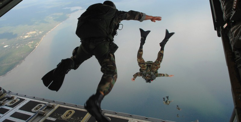 U.S. Air Force Airmen from the 720th Special Tactics Group out of Hurlburt Field, Fla., jump out of a C-130J Hercules aircraft during water rescue training over the Destin coastline in Florida Oct. 3, 2007. The training is designed to enhance aerial zodiac deployment and personnel recovery. The aircraft belongs to the 41st Airlift Squadron out of Little Rock Air Force Base in Arkansas. DoD photo by Senior Airman Julianne Showalter, U.S. Air Force. (Released)