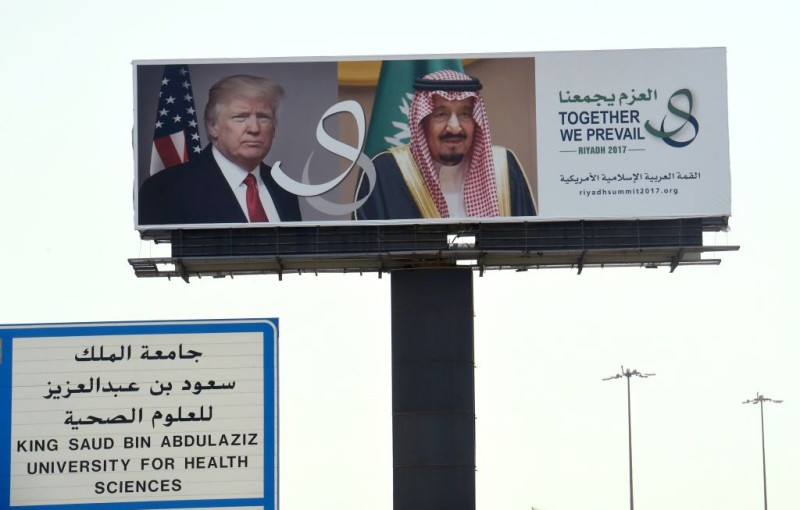 """A giant billboard bearing portraits of US President Donald Trump and Saudi Arabia's King Salman, is seen on a main road in Riyadh, on May 19, 2017.  Trump, on his first foreign trip since taking office in January, will tell Muslim leaders of his """"hopes for a peaceful vision of Islam"""" as he seeks support for the war against radical Islamists, Washington has said. / AFP PHOTO / FAYEZ NURELDINE        (Photo credit should read FAYEZ NURELDINE/AFP/Getty Images)"""