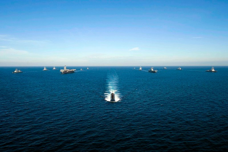 """EAST SEA - JULY 26: (EDITORS NOTE: Image has been reviewed by U.S. Military prior to transmission.) In this handout image provided by the U.S. Navy, U.S. Navy and South Korean ships sail in a 13-ship formation led by the Los Angeles-class attack submarine USS Tuscon (SSN 770) on July 26, 2010 in the East Sea off of the Korean peninsula. The United States and South Korea are conducting the combined alliance maritime and air readiness exercise """"Invincible Spirit"""" in the seas east of the Korean peninsula from July 25-28, 2010. This is the first in a series of joint military exercises that will occur over the coming months in the East and West Seas. The exercise, the first joint drill after the sinking of the South Korean corvette Cheonan in March 2010, has drawn condemnation from Pyongyang, North Korea.  (Photo by Mass Communication Specialist 3rd Class Adam K. Thomas/U.S. Navy via Getty Images)"""