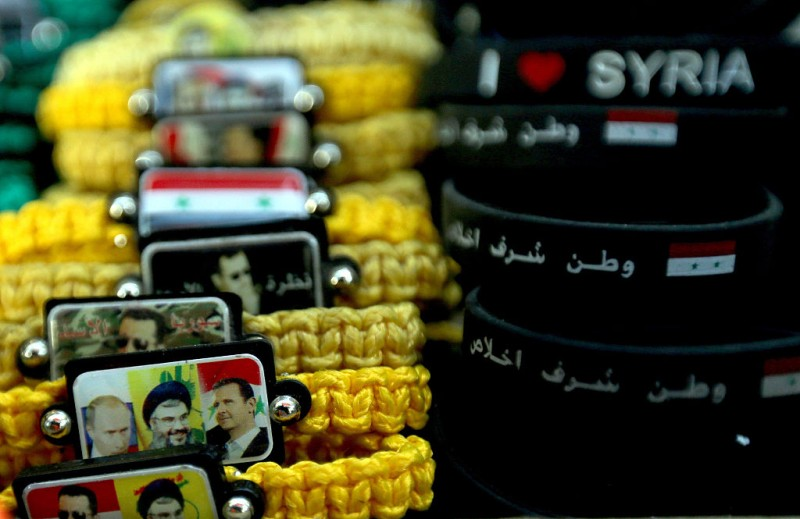 Bracelets bearing portraits of Syrian President Bashar al-Assad (R), his Russian counterpart Vladimir Putin (L) and Hassan Nasrallah (C) the leader of the Lebanese Shiite movement Hezbollah, are displayed at a handicrafts shop in the Syrian capital, Damascus, on February 4, 2016.  Syrian government troops moved closer to encircling rebels in the country's second city Aleppo, threatening a total siege after cutting their main supply line.  / AFP / JOSEPH EID        (Photo credit should read JOSEPH EID/AFP/Getty Images)