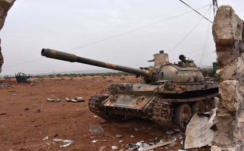 A picture shows a T-54 tank at a position of Syrian pro-government forces in Aleppo's Sheikh Saeed district as troops advance in the southeastern edges of the divided city on November 30, 2016. More than 50,000 Syrians have joined a growing exodus of terrified civilians from the besieged rebel-held east of Aleppo, the Syrian Observatory for Human Rights monitor said, as the UN Security Council was set for emergency talks on fighting in the city. Regime forces and allied fighters now fully control the city's northeast and pressed their offensive on November 30 on Aleppo's southeastern edges, advancing in the Sheikh Saeed district, according to state news agency SANA. / AFP / George OURFALIAN        (Photo credit should read GEORGE OURFALIAN/AFP/Getty Images)