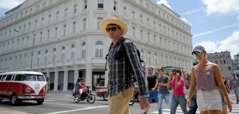Tourists walk near the Manzana Kempinski Hotel, the first luxury five star plus tourist facility in Cuba, on May 22, 2017. / AFP PHOTO / YAMIL LAGE        (Photo credit should read YAMIL LAGE/AFP/Getty Images)