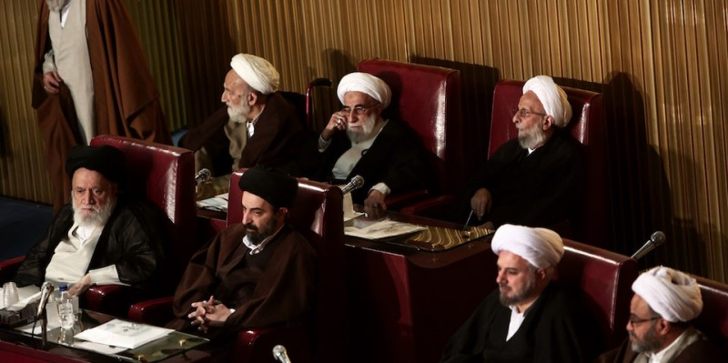 Members of Iran's Assembly of Experts, Mohammad Taghi Mesbah-Yazdi (up-R) and head of the Guardian Council, Ahmad Jannati (up-C), attend a session to appoint a new chairman on March 10, 2015 in Tehran. The Assembly of Experts, the clerics who appoint and can dismiss the country's supreme leader, picked the ultraconservative Ayatollah Mohammad Yazdi as their new chairman in a surprise appointment. AFP PHOTO / BEHROUZ MEHRI        (Photo credit should read BEHROUZ MEHRI/AFP/Getty Images)