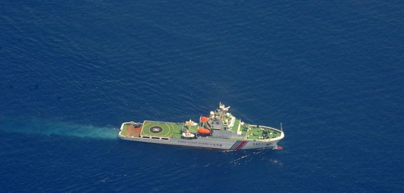 A China Coast Guard ship (bottom) and a Philippine supply boat engage in a stand off as the Philippine boat attempts to reach the Second Thomas Shoal, a remote South China Sea a reef claimed by both countries, on March 29, 2014. The Philippine ship finally slipped past the Chinese blockade to reach Second Thomas Shoal, where a handful of Filipino marines are stationed on a Navy vessel that has been grounded there since 1999 to assert their nation's sovereignty.              AFP PHOTO / Jay DIRECTO        (Photo credit should read JAY DIRECTO/AFP/Getty Images)
