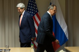 TOPSHOT - US Secretary of State John Kerry (L) and Russian Foreign Minister Sergey Lavrov arrive for talks on the Syria peace process in Zurich on January 20, 2016, in Davos. US Secretary of State John Kerry met his Russian counterpart Sergei Lavrov for talks on the Syria peace process, with a fresh round of dialogue between the warring parties set to begin next week. / AFP / AP POOL / Jacquelyn Martin        (Photo credit should read JACQUELYN MARTIN/AFP/Getty Images)