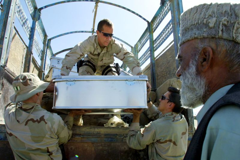 "405831 03: U.S. Soldiers, From The 1St Battalion, 3Rd Special Forces Group, Unload Boxes Of School Supplies At The Technical Academy Elementary School May 25, 2002 Outside Of Kabul, Afghanistan. U.S. Troops Are Helping Unicef Deliver Pre-Packaged ""School-In-A-Box"" Sets, Containing Pens, Pencils, Notebooks And Text Books, To 400 Local School Children.  (Photo By Natalie Behring-Chisholm/Getty Images)"