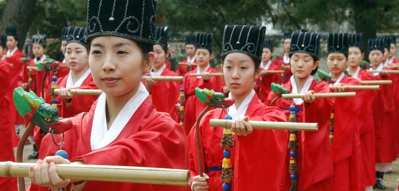 SEOUL, REPUBLIC OF KOREA:  Members of a traditional dance troupe perform during a ceremony celebrating Confucius and his instructions in Seoul, 09 March 2006. The ceremony was held at Sungkyunkwan, the state college of Korea's old kingdom for the last 500 years. AFP PHOTO/LEE HOON-KOO  (Photo credit should read LEE HOON-KOO/AFP/Getty Images)