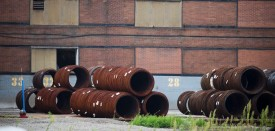 Rolls of wire are seen outside Johnstown Wire Technologies that produces wire and rod primarily for the transportation and construction industries,on September 8, 2016, in Johnstown, Pennsylvania.  The White House race could be decided in the Rust Belt -- a vast, decaying former industrial powerhouse in the US Midwest and Northeast where Hillary Clinton and Donald Trump are battling for the support of working class white voters. Johnstown, a former steel capital tucked away in a valley, is symbolic of the discontent that exists among the working class towards the Democratic Party. / AFP / DOMINICK REUTER        (Photo credit should read DOMINICK REUTER/AFP/Getty Images)