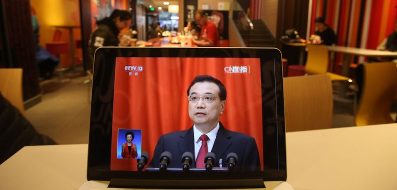 A live image shows Chinese Premier Li Keqiang delivering his report at the National People's Congress opening ceremony is seen on a laptop in a restaurant in Beijing Railway Station on March 5, 2017. China's rubber-stamp congress opened on March 5, 2017 in an annual pageant of Communist-controlled democracy. / AFP PHOTO / STR        (Photo credit should read STR/AFP/Getty Images)