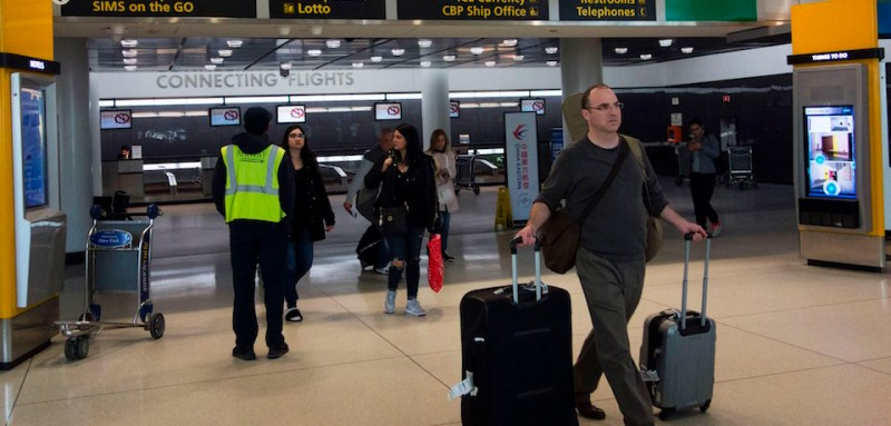Passengers arrive from international flights on March 21, 2017  at John F. Kennedy International Airport in New York.  Passengers traveling to the United States from 10 airports in eight Muslim-majority countries will be prohibited from bringing laptops, tablets and other portable electronic devices on board with them when they fly. The nine airlines affected by the US ban are Royal Jordanian, EgyptAir, Turkish Airlines, Saudi Arabian Airlines, Kuwait Airways, Royal Air Maroc, Qatar Airways, Emirates and Etihad Airways. / AFP PHOTO / DON EMMERT        (Photo credit should read DON EMMERT/AFP/Getty Images)