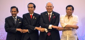 """(L to R) Brunei's Sultan Hassanal Bolkiah, Indonesia's President Joko Widodo, Malaysia's Prime Minister Najib Razak and Philippines' President Rodrigo Duterte link hands during the 12th Brunei Darussalam-Indonesia-Malaysia-Philippines East Asian Growth Area (BIMP-EAGA) Summit, on the sidelines of the Association of Southeast Asian Nations (ASEAN) summit, in Manila on April 29, 2017. Philippine President Rodrigo Duterte warned Southeast Asian leaders on April 29 they were facing a """"massive"""" illegal drug menace that could destroy their societies, as he called for a united response. / AFP PHOTO / POOL / Noel CELIS        (Photo credit should read NOEL CELIS/AFP/Getty Images)"""