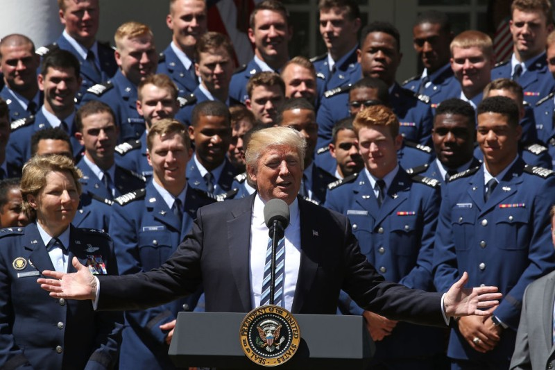 WASHINGTON, DC - MAY 02:  U.S. President Donald Trump speaks while standing with the U.S. Air Force Falcons football team before presenting them with the Commander-in-Chief trophy, in the Rose Garden at the White House, on May 2, 2017 in Washington, DC.  (Photo by Mark Wilson/Getty Images)