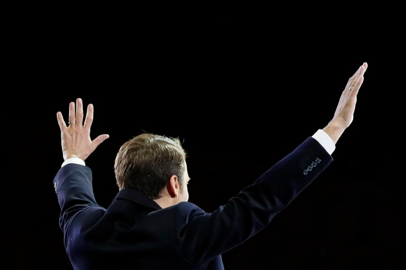 French president-elect Emmanuel Macron waves at supporters before delivering a speech in front of the Pyramid at the Louvre Museum in Paris on May 7, 2017, after the second round of the French presidential election. Emmanuel Macron was elected French president on May 7, 2017 in a resounding victory over far-right Front National (FN - National Front) rival after a deeply divisive campaign. / AFP PHOTO / POOL / THOMAS SAMSON        (Photo credit should read THOMAS SAMSON/AFP/Getty Images)