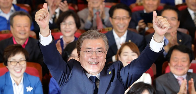 SEOUL, SOUTH KOREA - MAY 09:  South Korean presidential candidate Moon Jae-in of the Democratic Party of Korea reacts after a television report on an exit poll of the new president at the party's auditorium in the National assembly on May 9, 2017 in Seoul, South Korea. Polls have opened in South Korea's presidential election, called seven months early after former President Park Geun-hye was impeached for her involvement in a corruption scandal.  (Photo by Chung Sung-Jun/Getty Images)