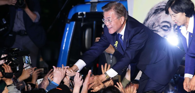 SEOUL, SOUTH KOREA - MAY 09:  South Korean President-elect Moon Jae-in, of the Democratic Party of Korea, celebrates with supporters at Gwanghwamun Square on May 9, 2017 in Seoul, South Korea. Moon Jae-in declared victory in South Korea's presidential election, which was called seven months early after former President Park Geun-hye was impeached for her involvement in a corruption scandal.  (Photo by Chung Sung-Jun/Getty Images)