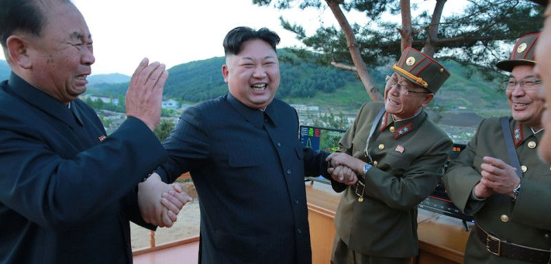"TOPSHOT - This picture taken on May 14, 2017 and released from North Korea's official Korean Central News Agency (KCNA) on May 15 shows North Korean leader Kim Jong-Un (2nd L) reacting during a test launch of a ground-to-ground medium long-range strategic ballistic rocket Hwasong-12 at an undisclosed location. / AFP PHOTO / KCNA VIA KNS / STR / South Korea OUT / REPUBLIC OF KOREA OUT   ---EDITORS NOTE--- RESTRICTED TO EDITORIAL USE - MANDATORY CREDIT ""AFP PHOTO/KCNA VIA KNS"" - NO MARKETING NO ADVERTISING CAMPAIGNS - DISTRIBUTED AS A SERVICE TO CLIENTS THIS PICTURE WAS MADE AVAILABLE BY A THIRD PARTY. AFP CAN NOT INDEPENDENTLY VERIFY THE AUTHENTICITY, LOCATION, DATE AND CONTENT OF THIS IMAGE. THIS PHOTO IS DISTRIBUTED EXACTLY AS RECEIVED BY AFP.  /         (Photo credit should read STR/AFP/Getty Images)"