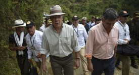 Colombian President Juan Manuel Santos (C) arrives at a coca plantation in Pueblo Nuevo, Briceno municipality, Antioquia department, Colombia, on May 15, 2017.  The Colombian government and the Revolutionary Armed Forces of Colombia (FARC) leftist guerrillas inaugurated a plan to eradicate coca plantations and replace them with legal crops. / AFP PHOTO / RAUL ARBOLEDA        (Photo credit should read RAUL ARBOLEDA/AFP/Getty Images)