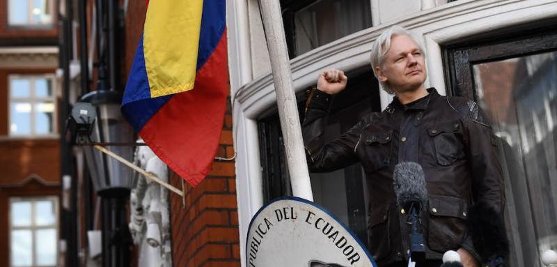 "Wikileaks founder Julian Assange raises his fist prior to addressing the media on the balcony of the Embassy of Ecuador in London on May 19, 2017. Ecuador urged Britain today to ""grant safe passage"" out of the country to WikiLeaks founder Julian Assange after Sweden dropped a warrant that drove him to take refuge in Ecuador's London embassy. / AFP PHOTO / Justin TALLIS        (Photo credit should read JUSTIN TALLIS/AFP/Getty Images)"