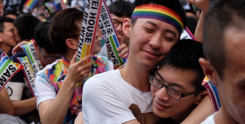 Same-sex activists hug outside the parliament in Taipei on May 24, 2017 as they celebrate the landmark decision paving the way for the island to become the first place in Asia to legalise gay marriage. Crowds of pro-gay marriage supporters in Taiwan on May 24 cheered, hugged and wept as a top court ruled in favour of same-sex unions. / AFP PHOTO / SAM YEH        (Photo credit should read SAM YEH/AFP/Getty Images)