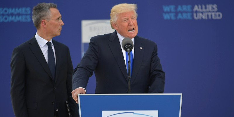US President Donald Trump (C) delivers a speech next to NATO Secretary General Jens Stoltenberg (L) during the unveiling ceremony of the Berlin Wall monument, during the NATO (North Atlantic Treaty Organization) summit at the NATO headquarters, in Brussels, on May 25, 2017.  / AFP PHOTO / Mandel NGAN        (Photo credit should read MANDEL NGAN/AFP/Getty Images)