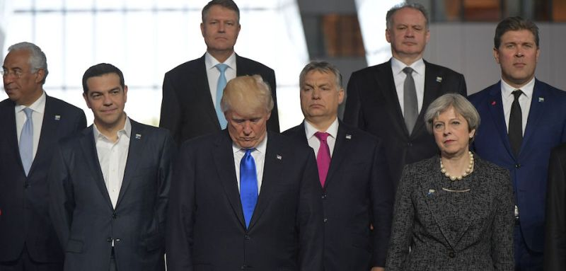 US President Donald Trump (front row C) reacts as he stands by (front row from L) Portuguese Prime Minister Antonio Costa, Greek Prime Minister Alexis Tsipras, Hungary's Prime Minister Viktor Orban, Britain's Prime Minister Theresa May, (back row from L Romanian President Klaus Werner Iohannis, Slovakia's President Andrej Kiska and Iceland's Prime Minister Bjarni Benediktsson, during a family picture during the NATO (North Atlantic Treaty Organization) summit at the NATO headquarters, in Brussels, on May 25, 2017. / AFP PHOTO / Mandel NGAN        (Photo credit should read MANDEL NGAN/AFP/Getty Images)