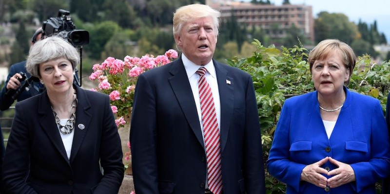 (L-R) Britain's Prime Minister Theresa May, US President Donald Trump and German Chancellor Angela Merkel arrive to watch an Italian flying squadron during the Summit of the Heads of State and of Government of the G7, the group of most industrialized economies, plus the European Union, on May 26, 2017 in Taormina, Sicily. The leaders of Britain, Canada, France, Germany, Japan, the US and Italy will be joined by representatives of the European Union and the International Monetary Fund (IMF) as well as teams from Ethiopia, Kenya, Niger, Nigeria and Tunisia during the summit from May 26 to 27, 2017. / AFP PHOTO / POOL / STEPHANE DE SAKUTIN        (Photo credit should read STEPHANE DE SAKUTIN/AFP/Getty Images)