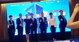 Nicole Kushner Meyer (3L), the sister of US White House senior adviser Jared Kushner, poses at a promotional event in Shanghai on May 7, 2017.  The sister of White House senior adviser Jared Kushner urged wealthy Chinese on May 7 to buy stakes in real estate through a controversial programme that offers US residency in exchange for investment. Nicole Kushner Meyer was in Beijing Saturday and in Shanghai Sunday, seeking more than $150 million in investment in a luxury apartment complex project in New Jersey. / AFP PHOTO / ALBEE ZHANG        (Photo credit should read ALBEE ZHANG/AFP/Getty Images)