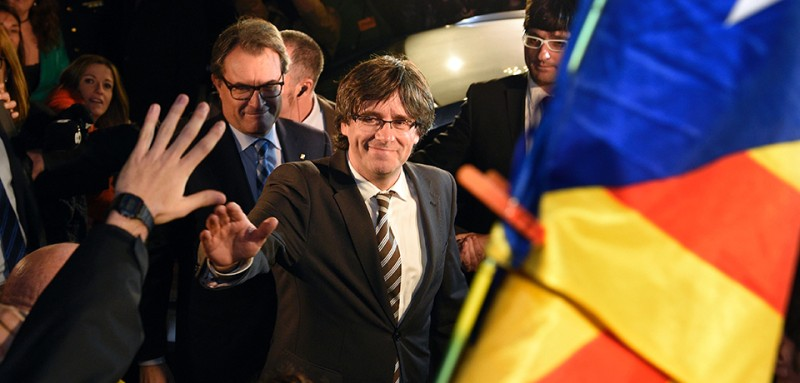 Carles Puigdemont, president of the government of Catalonia, waves to supporters in Barcelona on Jan. 10, 2016. (Lluis Gene/AFP/Getty Images)