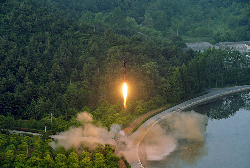 """TOPSHOT - This undated photo released by North Korea's official Korean Central News Agency (KCNA) on May 30, 2017 shows a test-fire of a ballistic missile at an undisclosed location in North Korea.  / AFP PHOTO / KCNA via KNS / STR / South Korea OUT / REPUBLIC OF KOREA OUT   ---EDITORS NOTE--- RESTRICTED TO EDITORIAL USE - MANDATORY CREDIT """"AFP PHOTO/KCNA VIA KNS"""" - NO MARKETING NO ADVERTISING CAMPAIGNS - DISTRIBUTED AS A SERVICE TO CLIENTS THIS PICTURE WAS MADE AVAILABLE BY A THIRD PARTY. AFP CAN NOT INDEPENDENTLY VERIFY THE AUTHENTICITY, LOCATION, DATE AND CONTENT OF THIS IMAGE. THIS PHOTO IS DISTRIBUTED EXACTLY AS RECEIVED BY AFP.  /         (Photo credit should read STR/AFP/Getty Images)"""